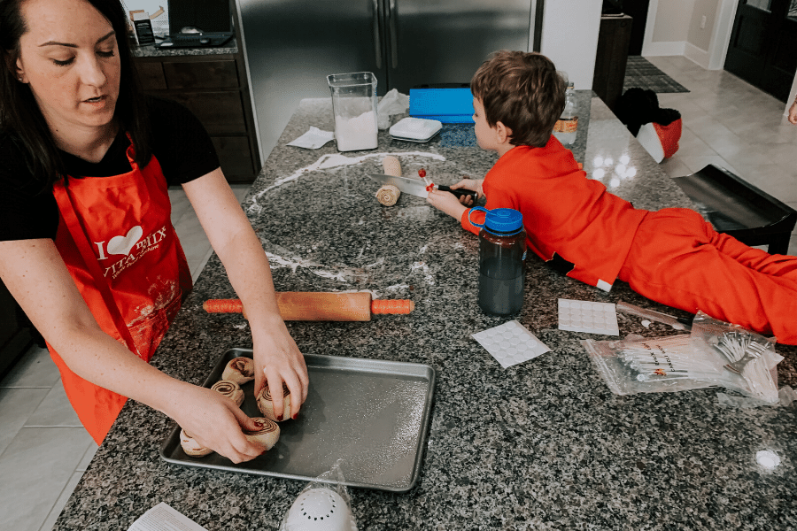 making cinnamon rolls with family